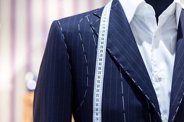 Suits on shop mannequins stock photo