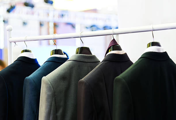 suits Row of men's suits hanging on the rack. businesswear stock pictures, royalty-free photos & images