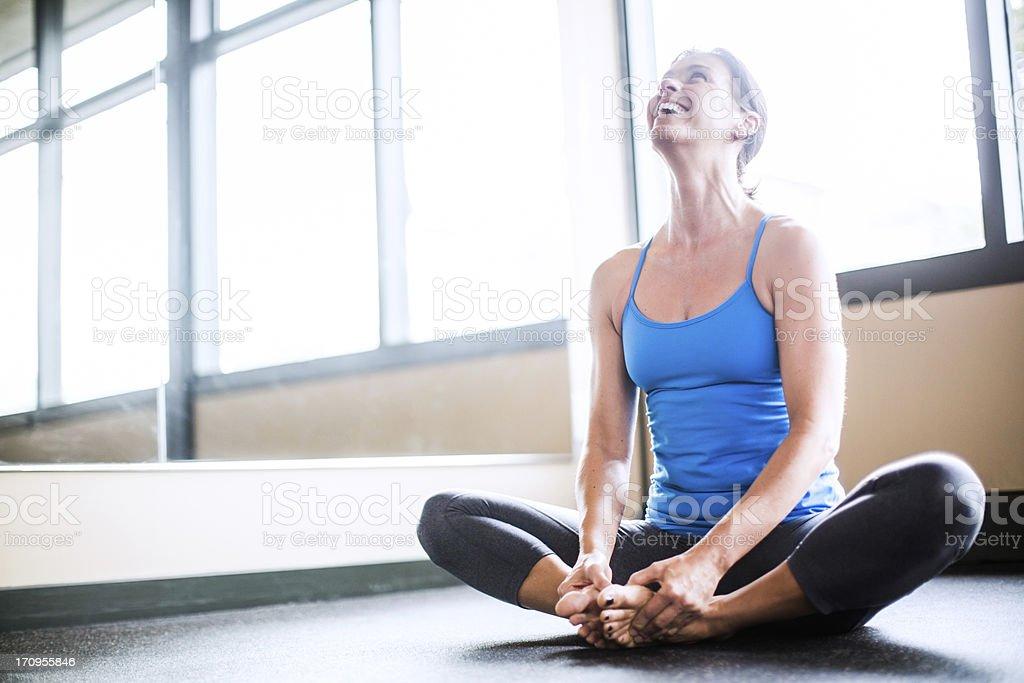 Sukhasana in Yoga Studio stock photo