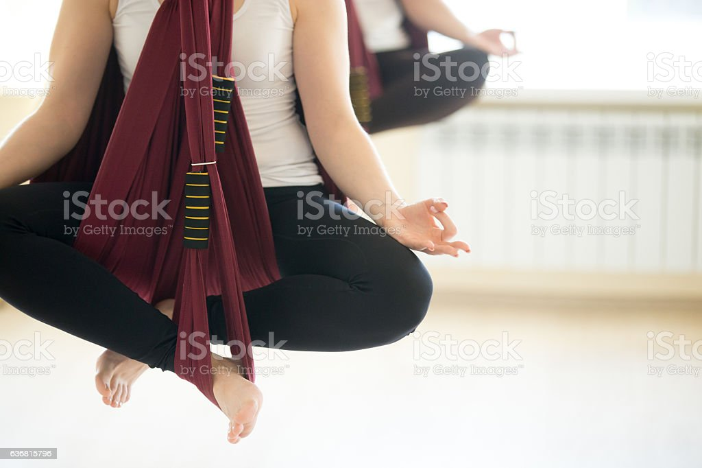 Sukhasana yoga pose in hammocks stock photo