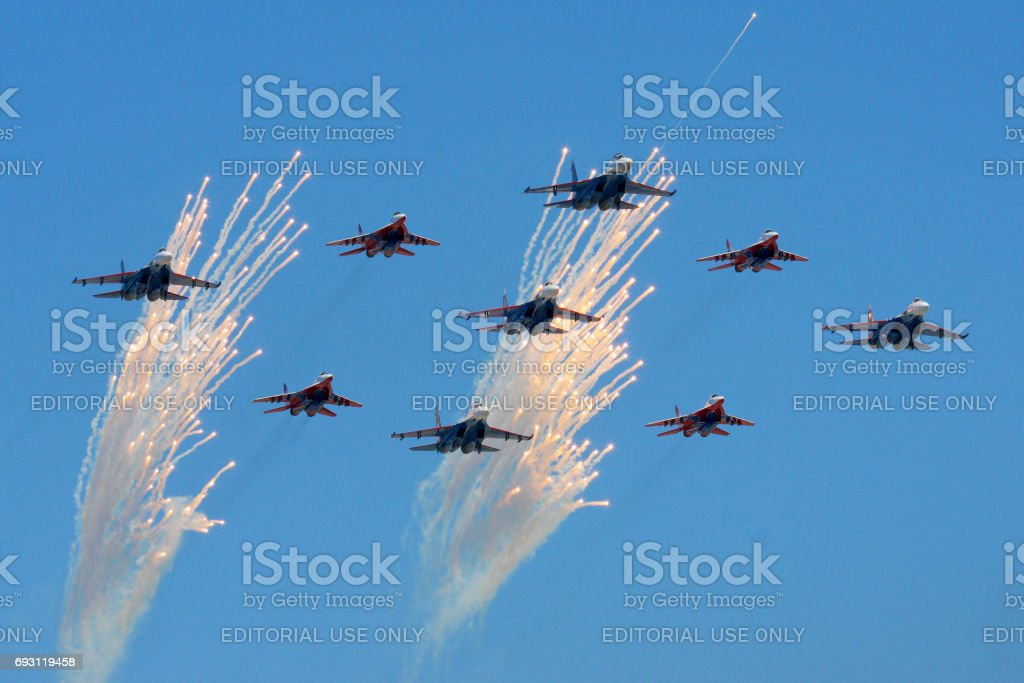 Sukhoi Su-27 and Mikoyan MiG-29 of Russian Air Force during Victory Day parade. stock photo
