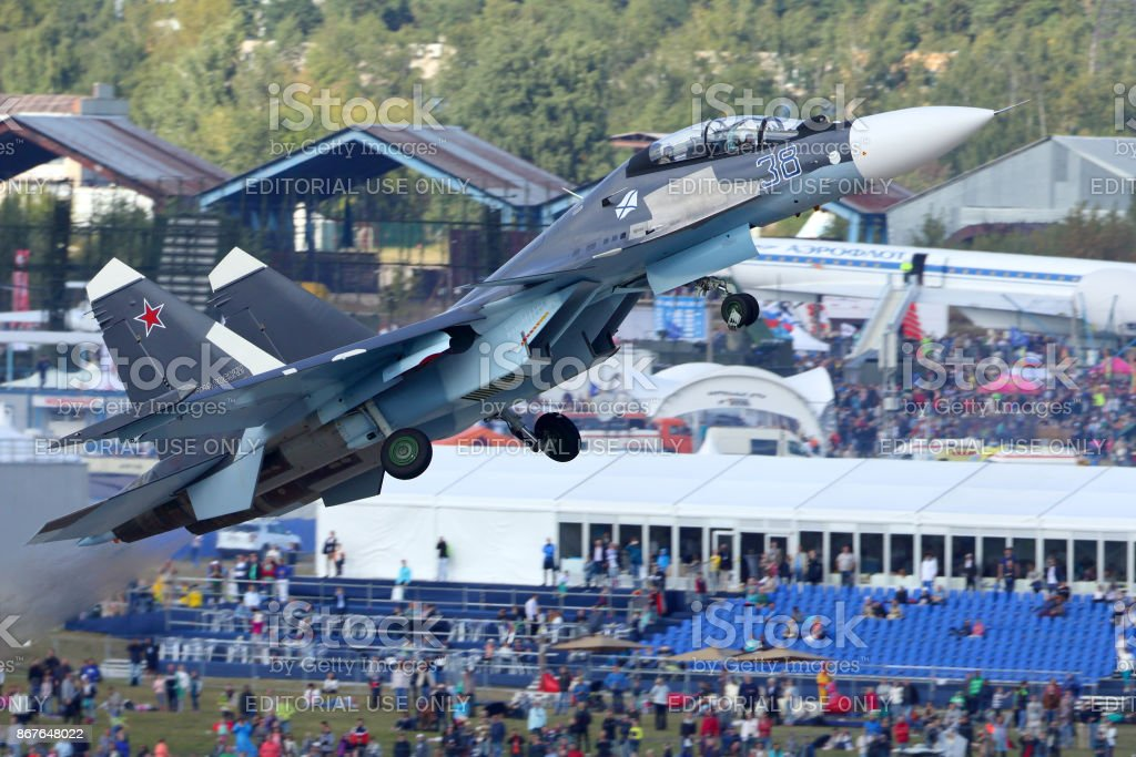 Sukhoi Su-30SM 38 BLACK of russian navy perfoming demonstration flight in Zhukovsky during MAKS-2015 airshow. stock photo