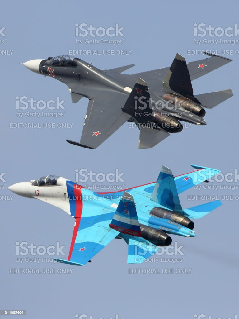 Sukhoi Su-30SM 56 RED an Su-27UB 17 RED of russian air force perfoming demonstration flight in Zhukovsky during MAKS-2015 airshow. stock photo