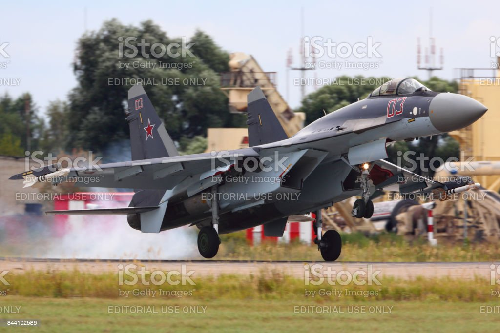 Sukhoi SU-35S of russian air force landing at Zhukovsky before MAKS-2015 airshow. stock photo