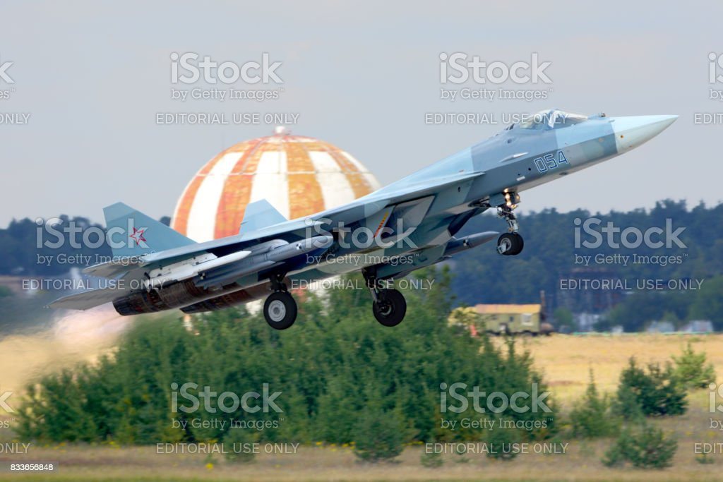 Sukhoi T-50 PAK-FA 054 WHITE of russian air force performing test flight with missiles at Zhukovsky. stock photo