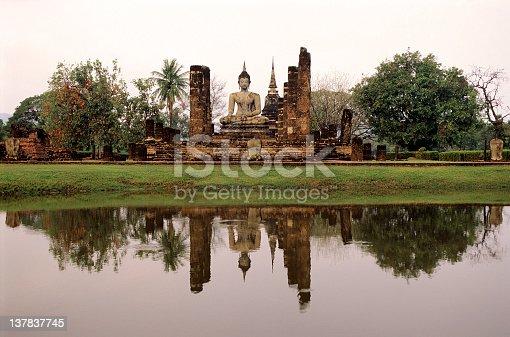 Ancient Buddha statue and temple at Wat Mahathat, Sukhothai