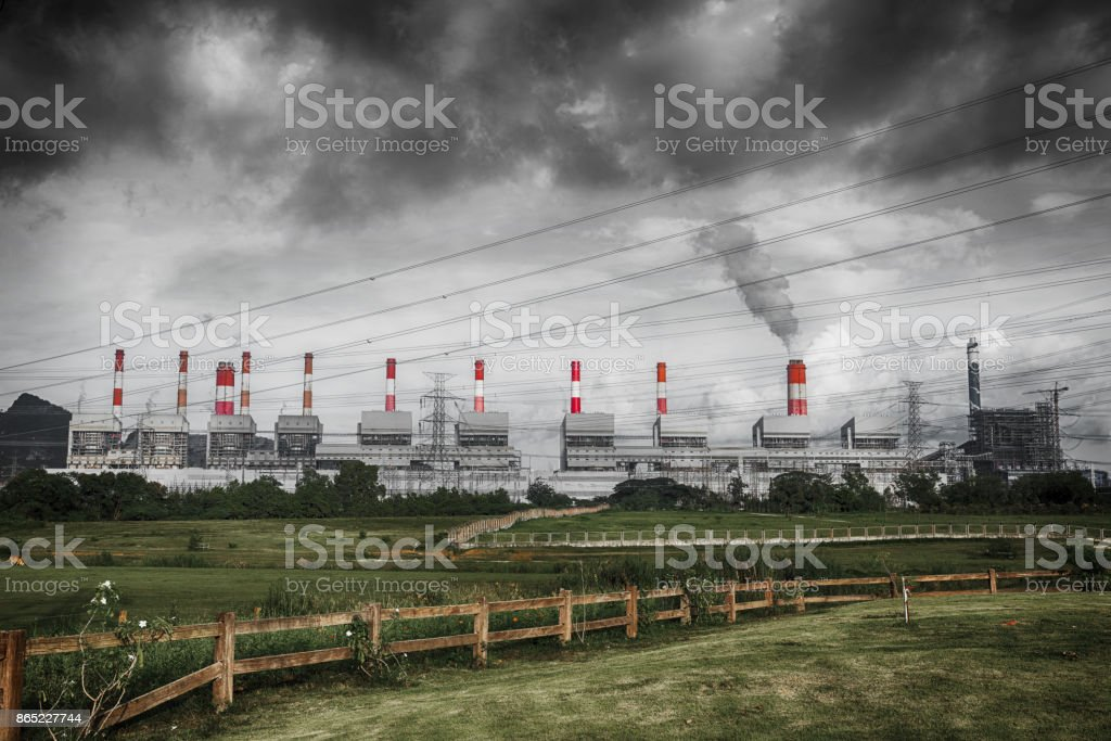 sulfer smoke cloud of pollution from coal power plant air environmental destruction stock photo