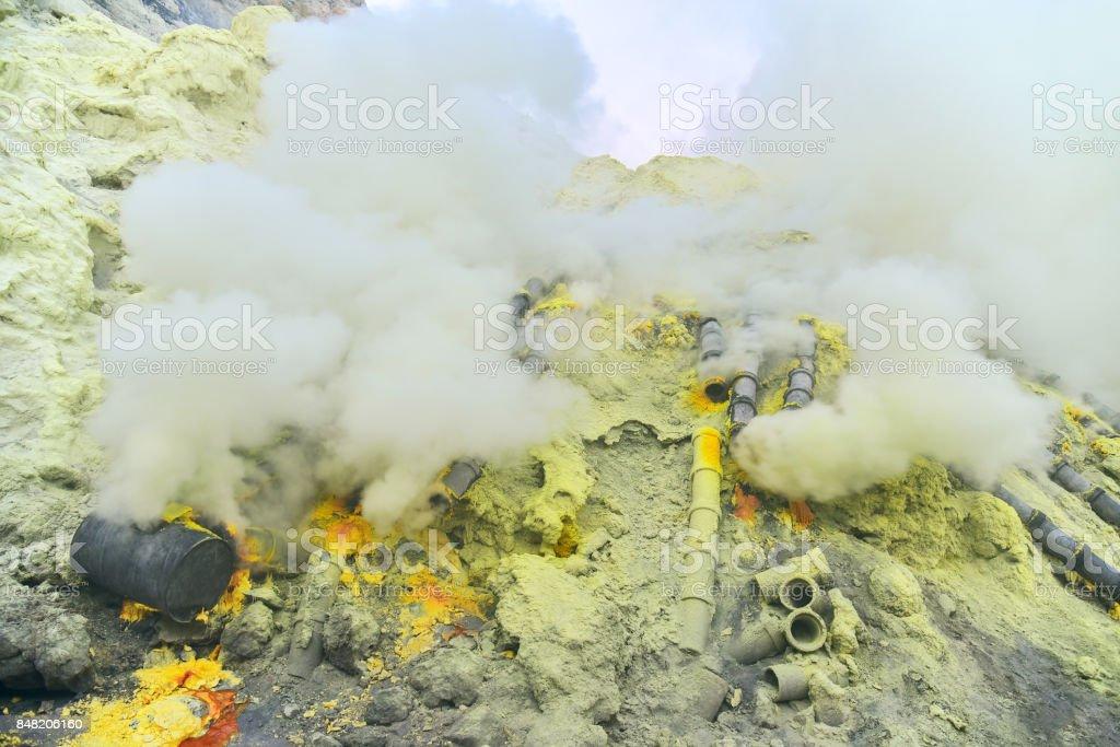 Sulfur in Kawah Ijen volcano crater stock photo