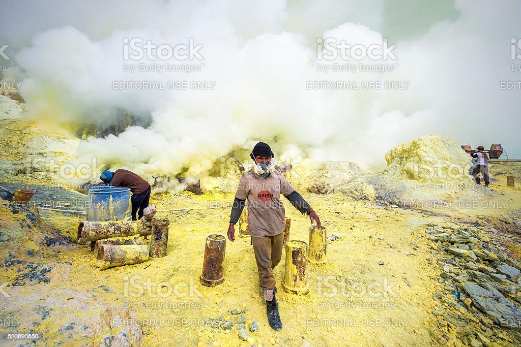 Sulfur Miners at Kawah Ijen Volcano in Java, Indonesia stock photo