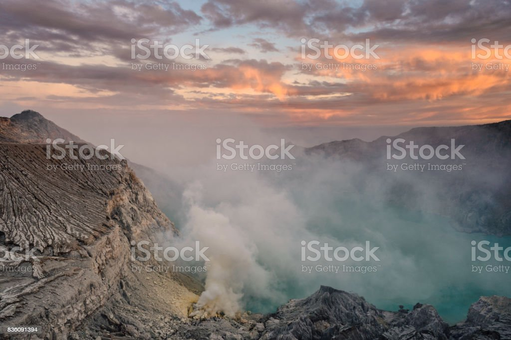 Sulfur mines at kawah ijen,indonesia.Sulfur mines view point.High angle shots.People look at sulfur mines. stock photo