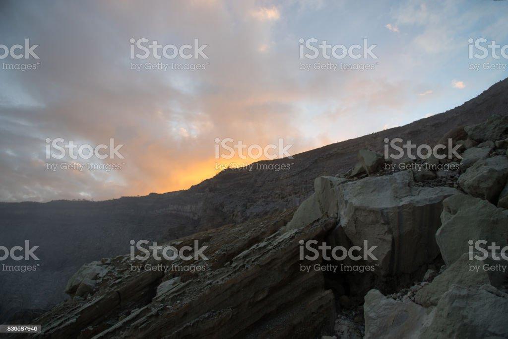 Sulfuric acidic big lake and mountains Kawah Ijen Volcano stock photo