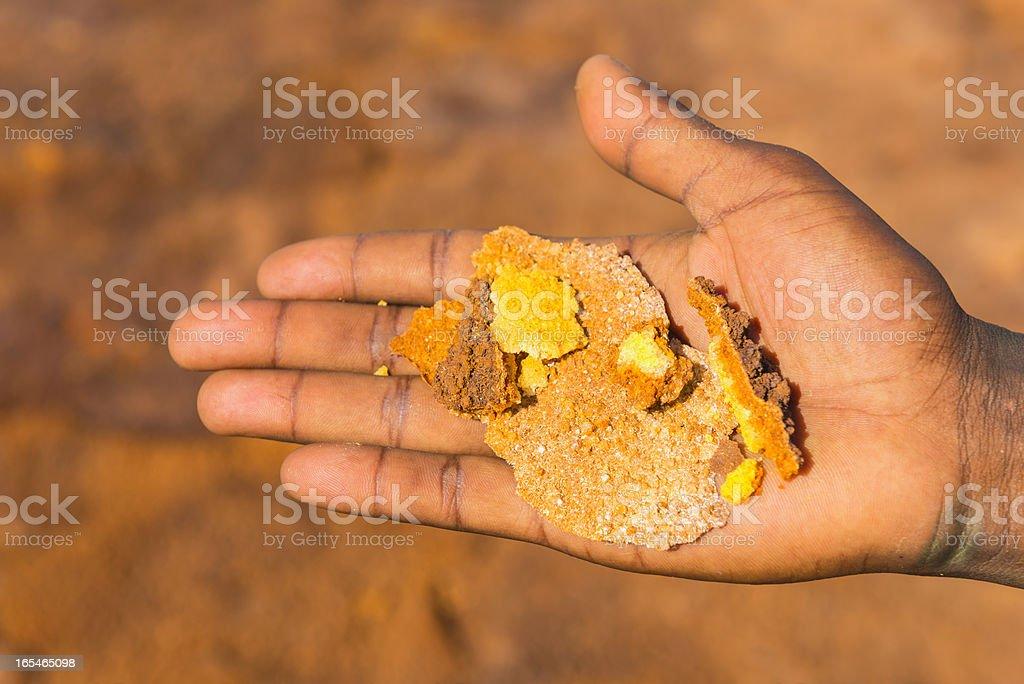 sulfuric crystals on human hand stock photo
