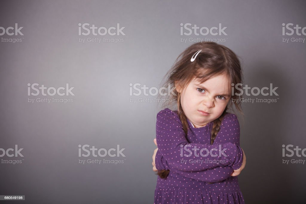 Sulking Girl stock photo