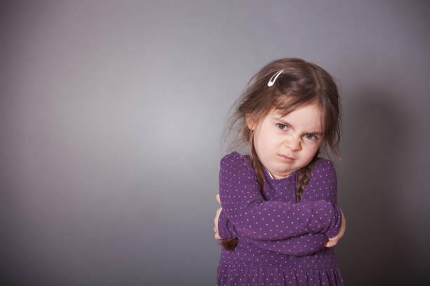 Sulking Girl stock photo