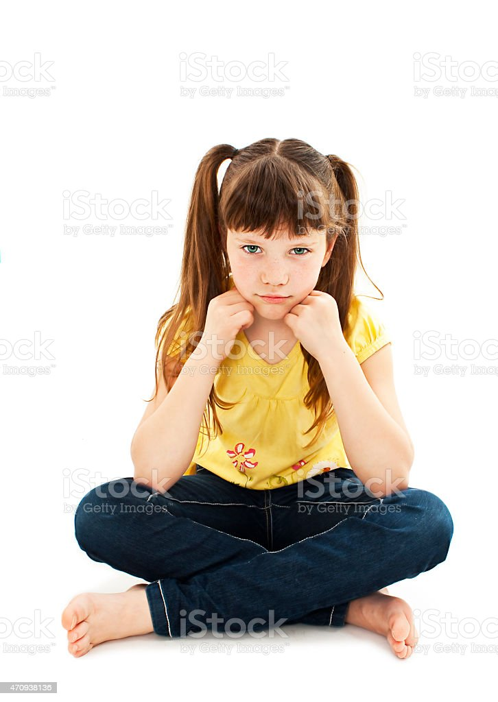 Sulky angry young girl child, sulking and pouting stock photo