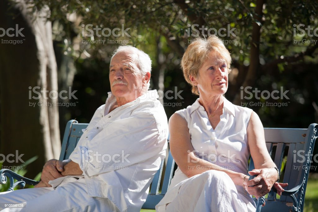 sulky senior couple in a garden in the spring стоковое фото