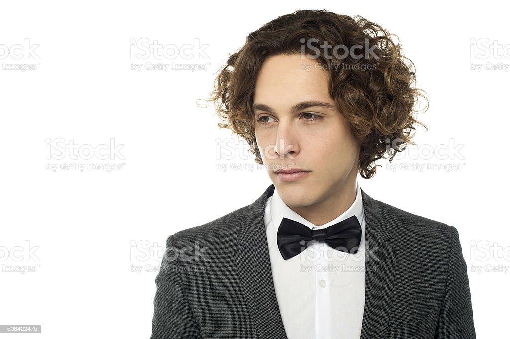 Sullen faced serious young groom stock photo
