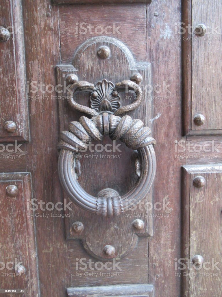 Close-up of the entrance door of the Hôtel de Sully, a Louis XIII...