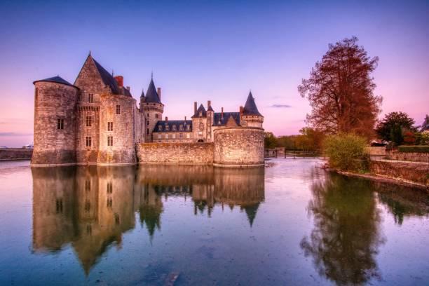 Sully sur Loire at sunrise, Loire Valley, France. stock photo