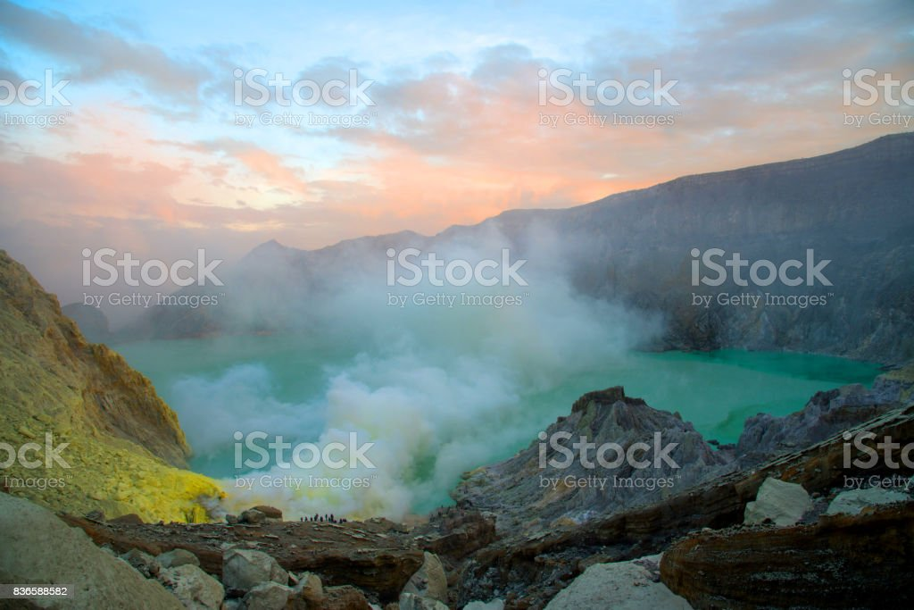 Sulphatic lake in crater of volcano Kawah Ijen at morning time, sunrise stock photo