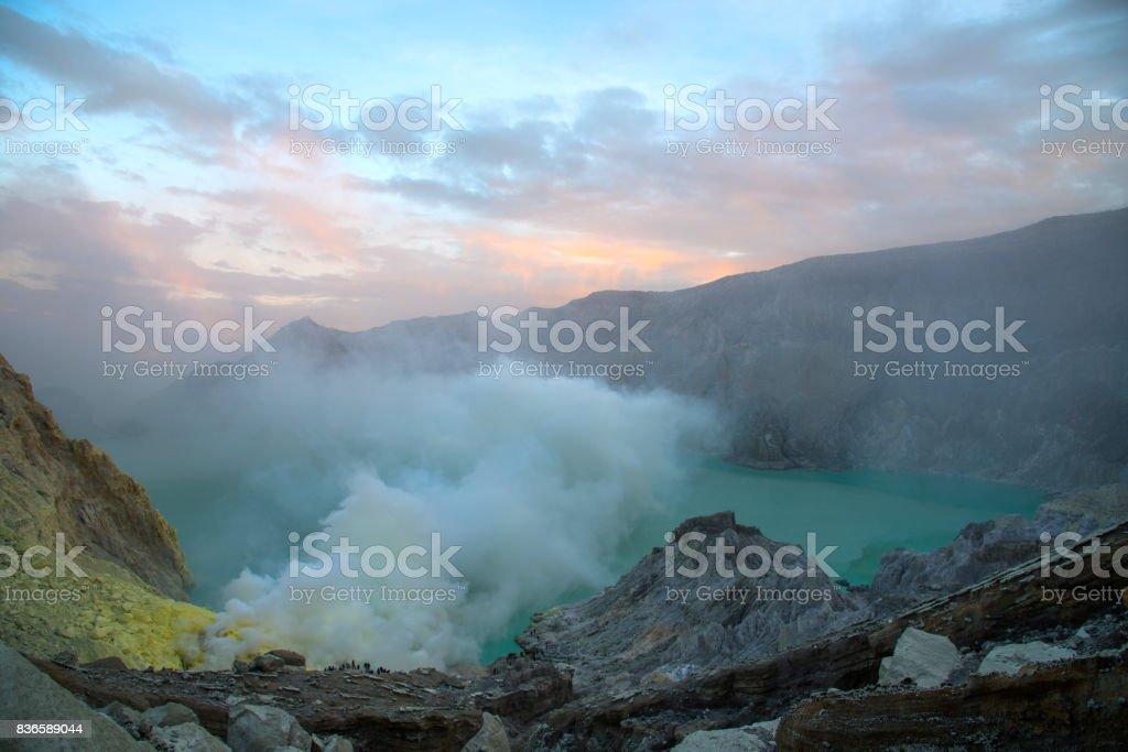 Sulphatic lake in crater of volcano Kawah Ijen stock photo