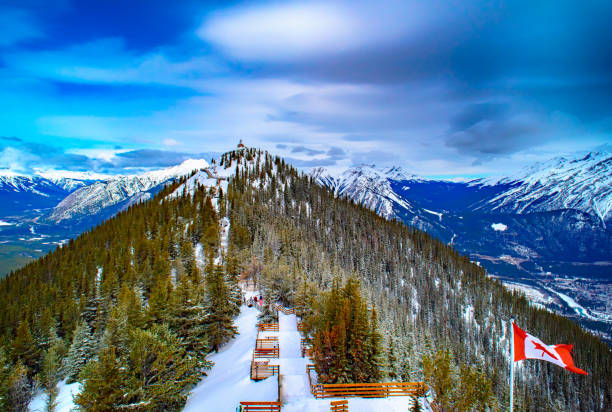 Sulphur Mountain in Banff National Park in the Canadian Rocky Mountains overlooking the town of Banff. stock photo
