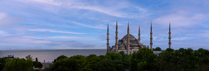 Sultan ahmed mosque ( Blue mosque ) in front of a cloudy day background. Front view,