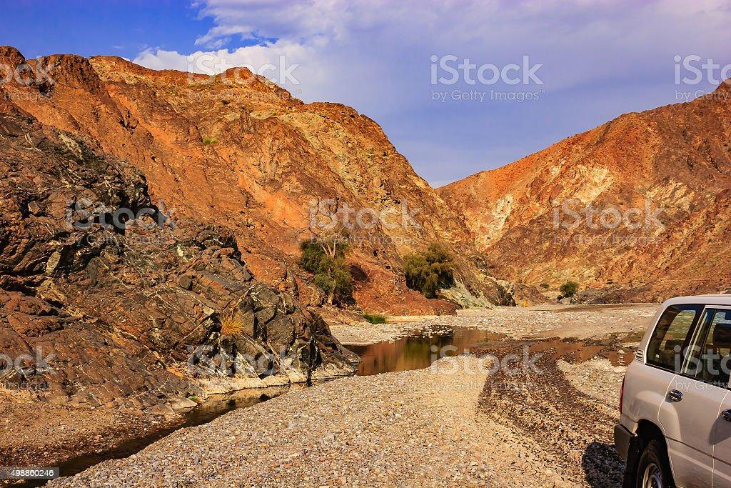 Sultanate of Oman: Off-roading in Arabian desert Wadi stock photo