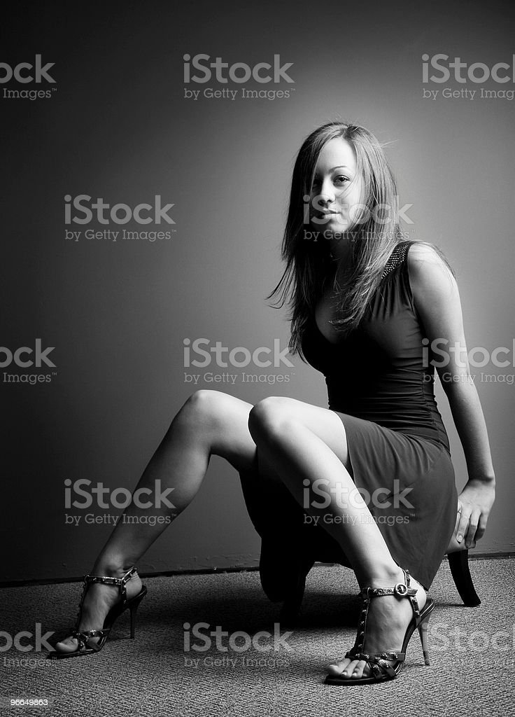 sultry brunette has nice legs stock photo