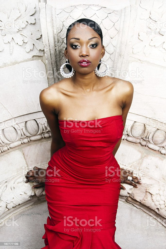 Sultry woman in red dress. stock photo