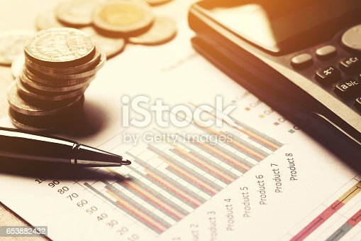864278180istockphoto Summary report and financial analyzing concept, Pen and calculator. 653882432