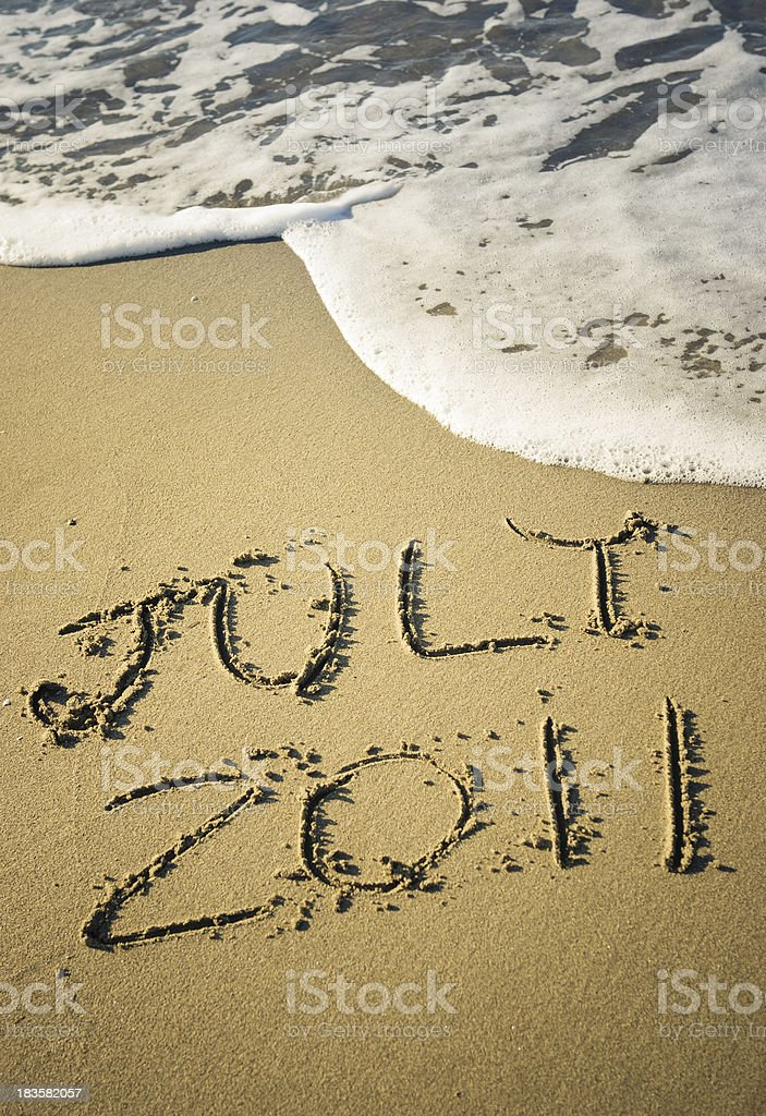 Summer 2011 message in the sand royalty-free stock photo