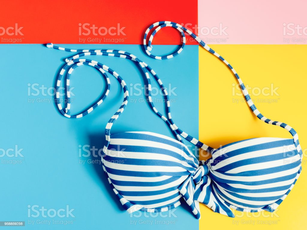 summer accessories and minimal flat lay concept from bikini, cloth and vacation item decorate on pastel and colorful background stock photo