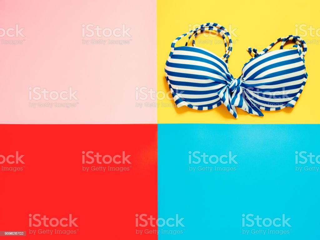 summer accessories and minimal flat lay concept from bikini, cloth decorate on pastel and colorful background stock photo