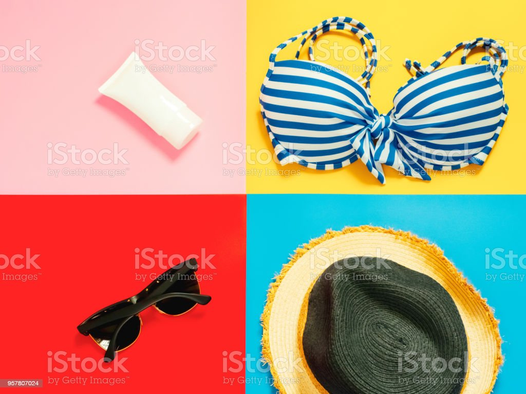 summer accessories and minimal flat lay concept from vacation item and skin care item decorate on pastel and colorful background stock photo