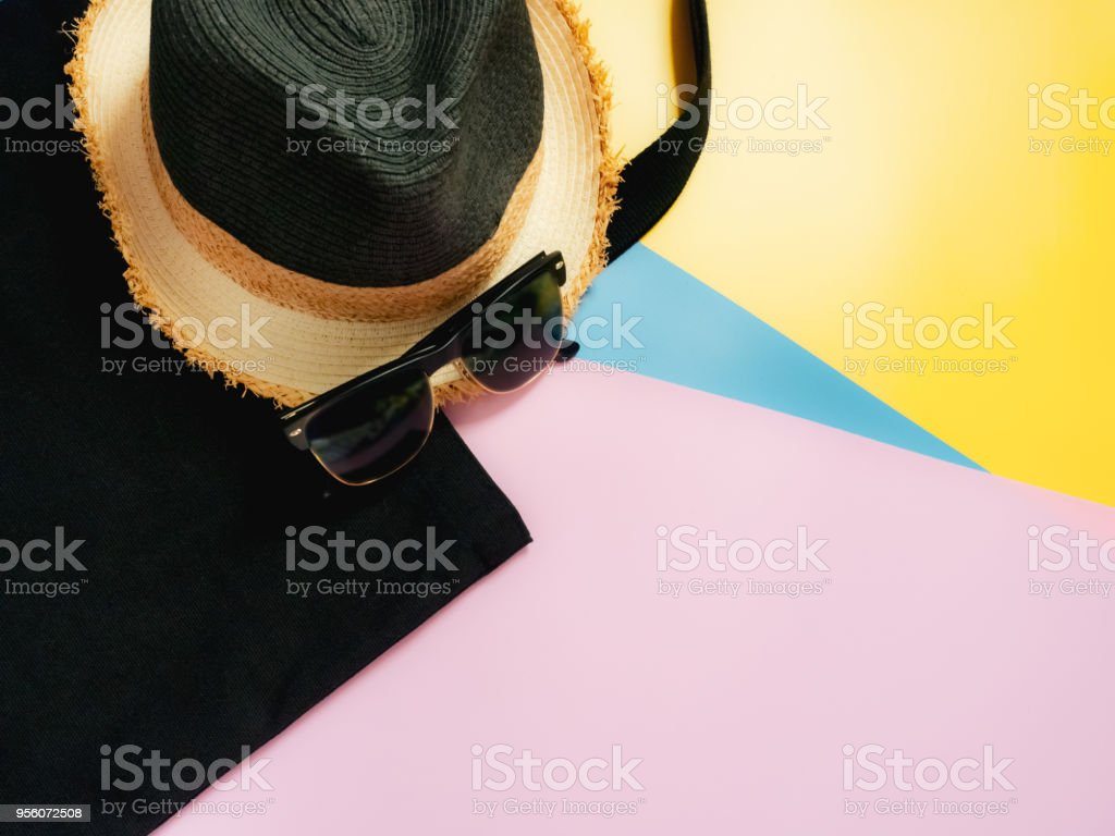 summer accessories and minimal flat lay concept from vintage bag and sunglasses decorate on pastel and colorful background stock photo