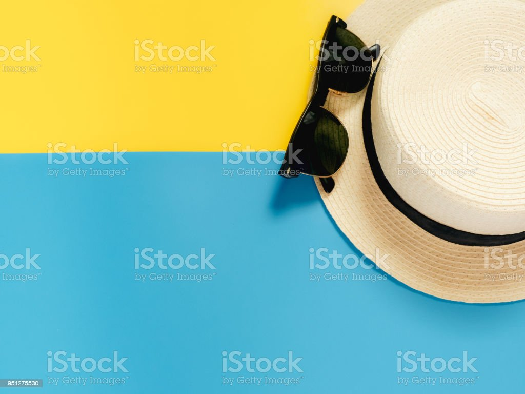 summer accessories and minimal flat lay concept from vintage hat and sunglasses decorate on pastel and colorful background stock photo