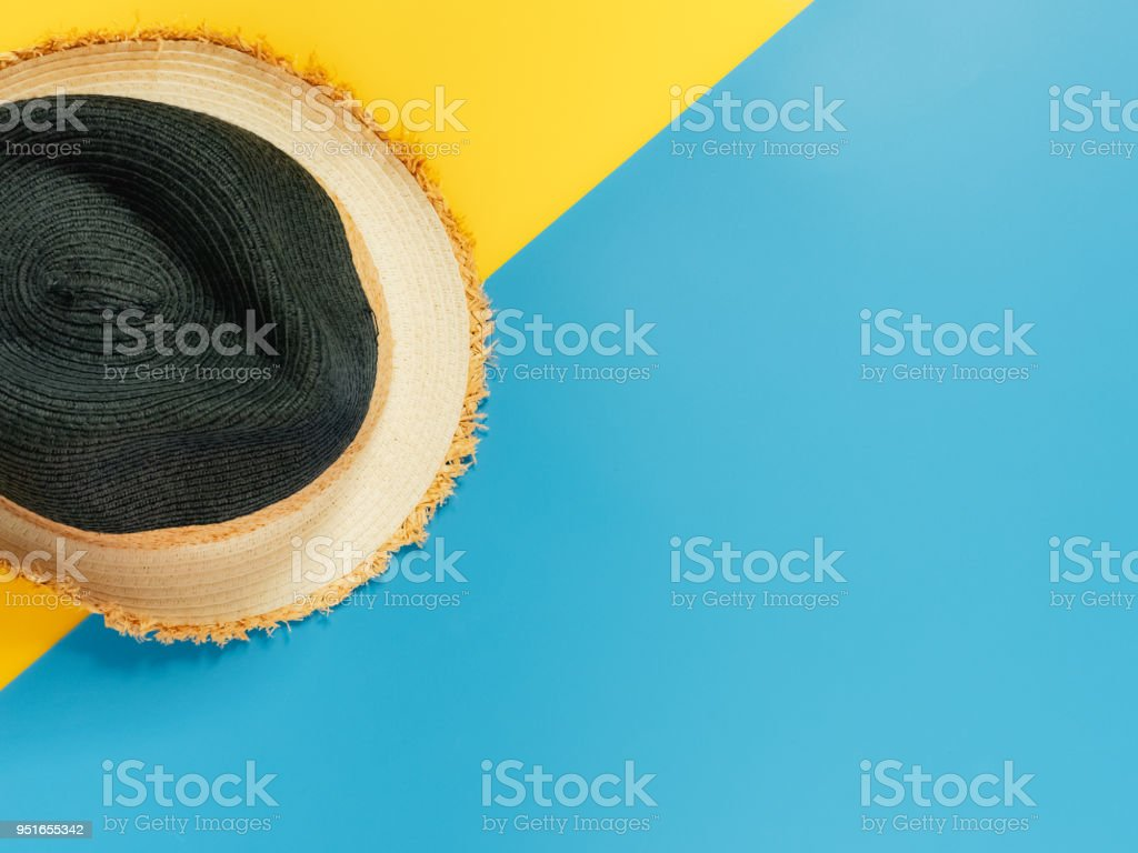 summer accessories and minimal flat lay concept from vintage hat decorate on pastel and colorful background stock photo