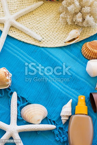 674650538istockphoto Summer Accessories Background. Top View of Summer Beach Accessories. Beach Hat, Sea Shells, Star Fish, Tanning Cream and Sunglasses on a Turquoise Blue Beach Towel. Tropical Summer Concept, Beach Background, Vacation and Travel Concept. 1159383073