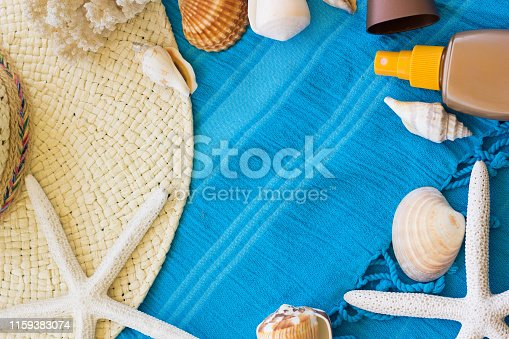 674650538istockphoto Summer Accessories Background. Top View of Summer Beach Accessories. Beach Hat, Sea Shells, Star Fish, Tanning Cream and Sunglasses on a Turquoise Blue Beach Towel. Tropical Summer Concept, Beach Background, Vacation and Travel Concept. 1159383074