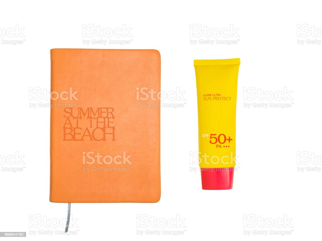 Summer accessories concept: Top view of summer accessories: book and sun uv protect lotion in yellow and orange tone isolated on white background with clipping path stock photo