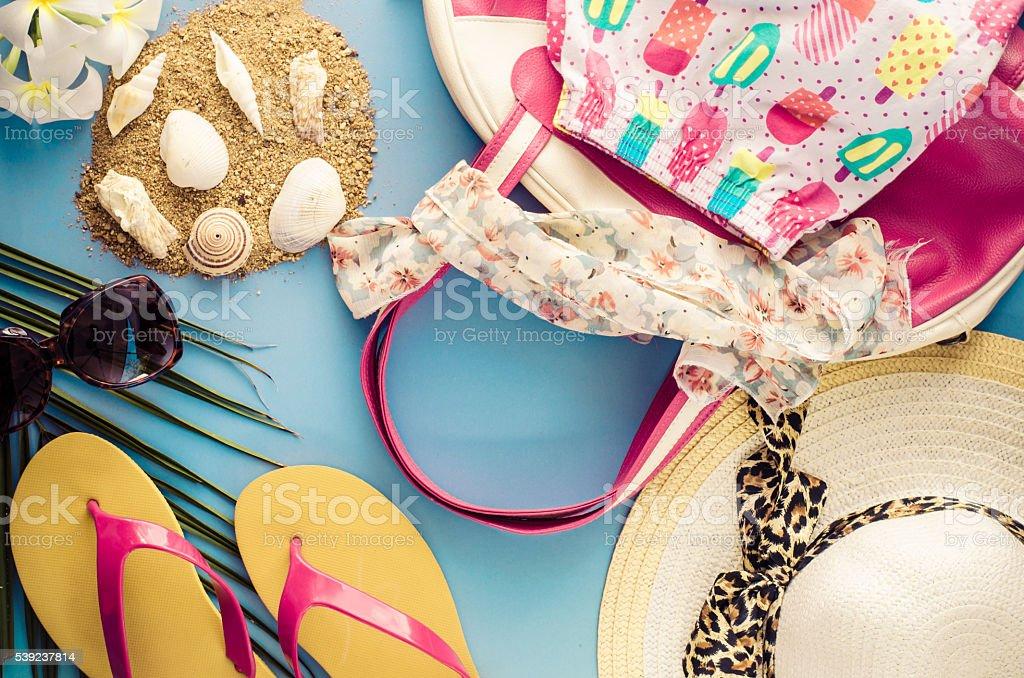 Summer accessories on blue background royalty-free stock photo