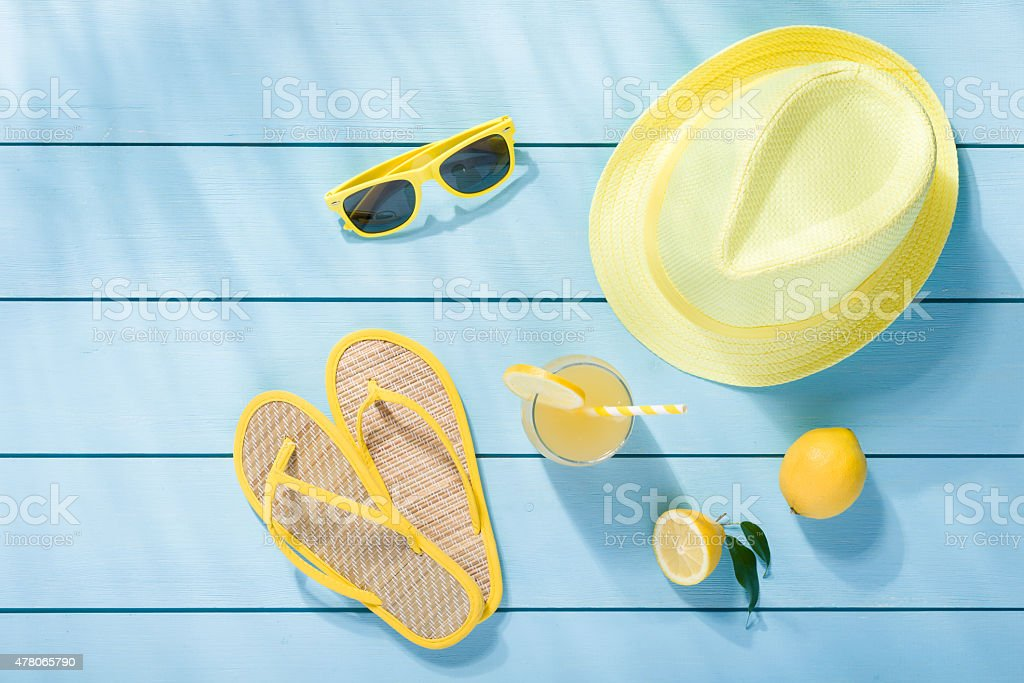 Summer accessories on blue wooden background top view stock photo
