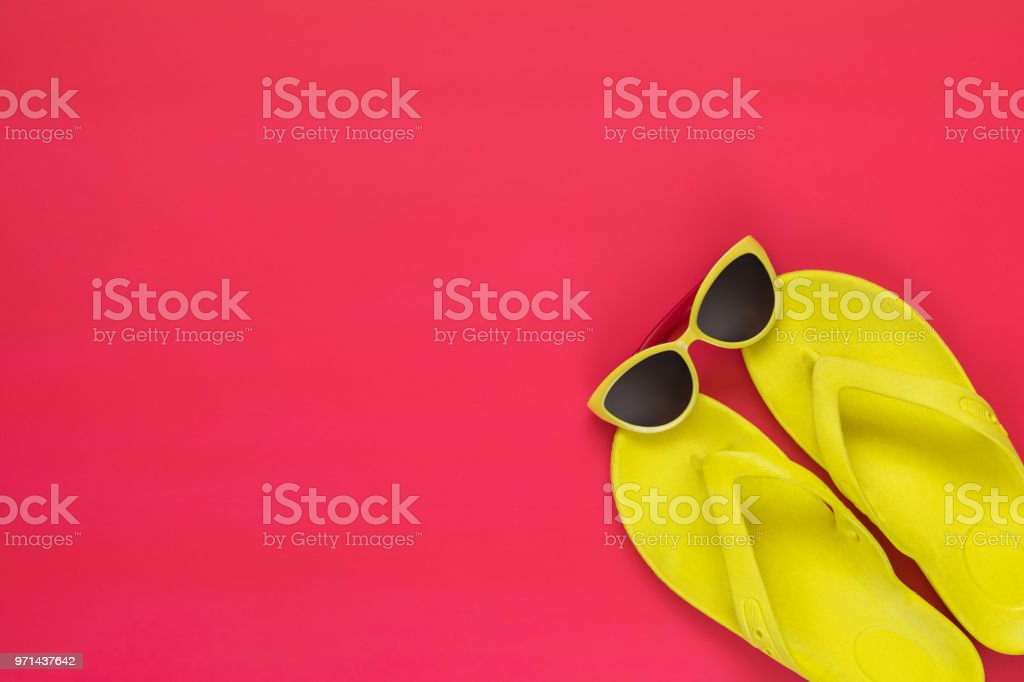 Summer accessories on pink floor. Flat lay, top view vacation background. stock photo