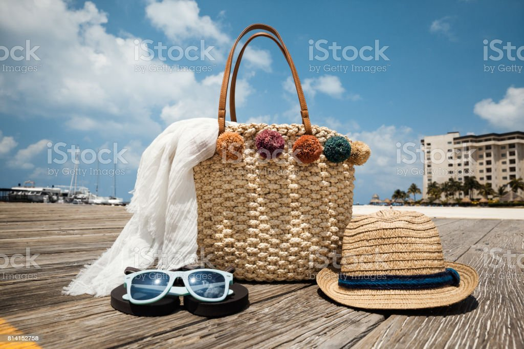 Summer accessories on the wooden bridge at the tropical beach stock photo