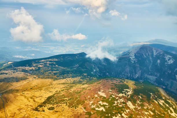Summer aerial view of Snezka mountain summit in Krkonose mountains, Czechia/ Poland. stock photo