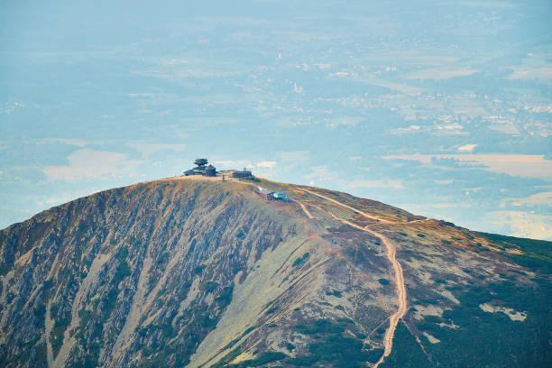 Summer aerial view of Snezka mountain summit in Krkonose mountains. stock photo