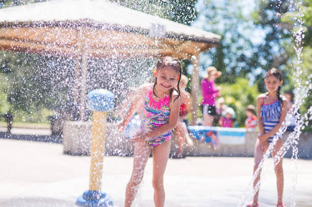 Summer afternoon at the splash pad stock photo