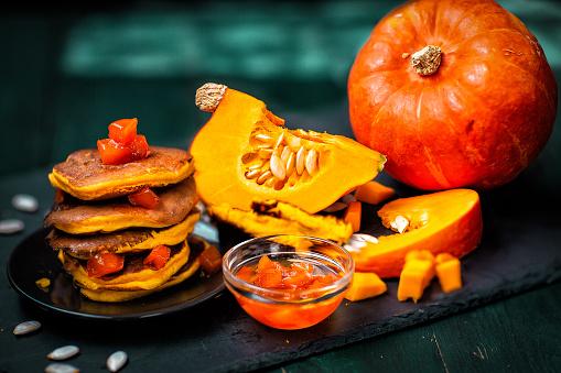 Summer and autumn cuisine. Pumpkin and pumpkin dishes.Jam and pumpkin pancakes.
