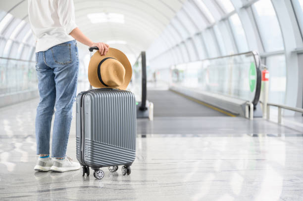 Summer and concept, A woman with suitcase walking in airport stock photo